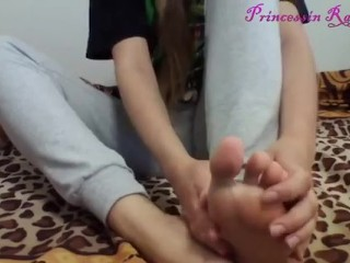 Extremely pretty blonde goddess shows her white socks, massages her feet