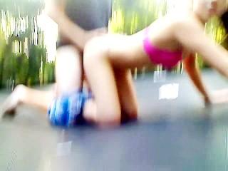 Amateur teens fuck like bunnies outdoors on a trampoline in her backyard
