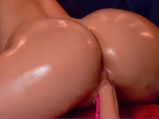a girl with an ass in oil is planted on a big fat cock until she cums