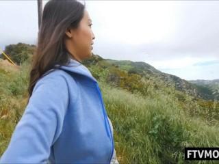 Busty asian MILF flashing big tits outdoors